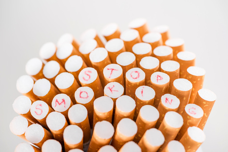 Studio shot of cigarettes isolated on grey, stop smoking concept