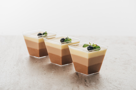 Delicious triple chocolate mousse desserts in glasses
