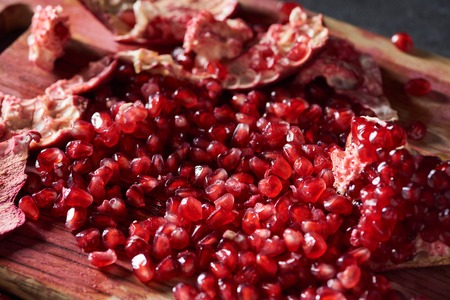 Close up shot of cut pomegranate on cutting board