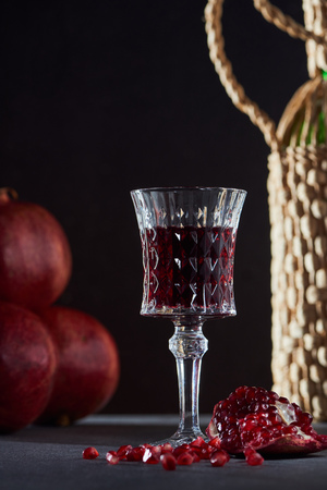 Studio shot of wineglass and fresh pomegranates