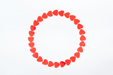 Top view of round frame made with red paper hearts isolated on white, st valentines day concept Stock Photo