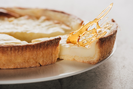 Close-up view of delicious flan cake with caramel on white plate Stock Photo