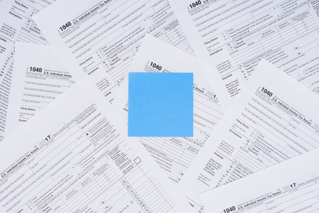 Top view of empty blue card with tax forms on background Stockfoto