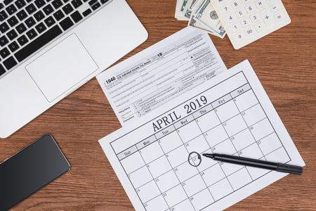 Top view of calendar with marked April 17 date on wooden desk Stock Photo