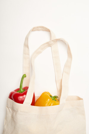 Studio shot of bell peppers in eco bag on white background Stock Photo
