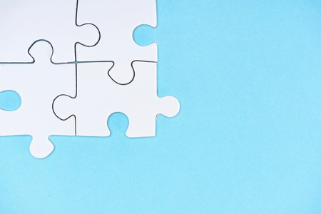 Top view of white puzzle pieces isolated on blue