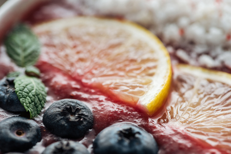 close up of blueberries, mint and sliced lemons in smoothie bowl Stok Fotoğraf