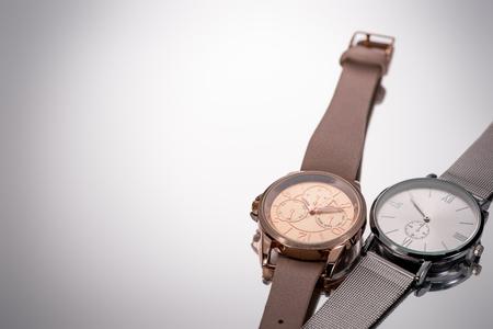 elegant swiss wristwatches lying on grey background