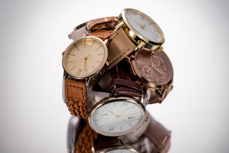 selective focus of elegant wristwatches on grey background