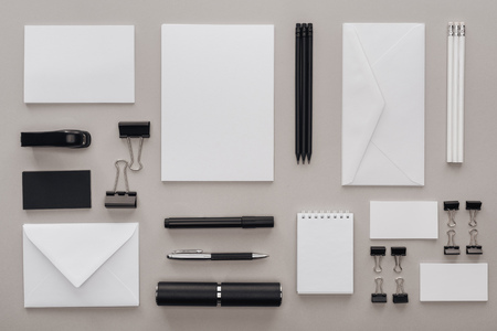 flat lay with black and white stationery on grey background 写真素材