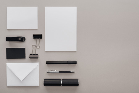 flat lay with black and white stationery at workplace on grey background with copy space