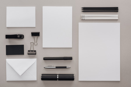 flat lay with black and white stationery at workplace on grey background