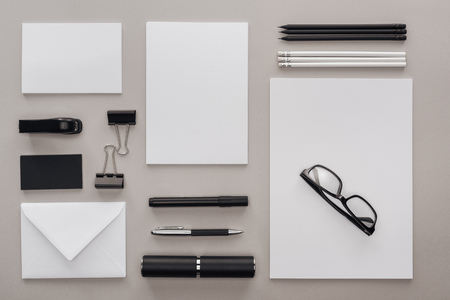 flat lay with black and white stationery and glasses at workplace on grey background 스톡 콘텐츠