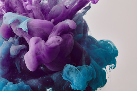 Abstract background with purple and blue swirls of paint