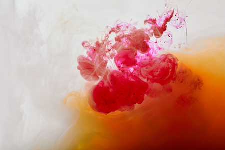 pink and orange swirls of paint on white background