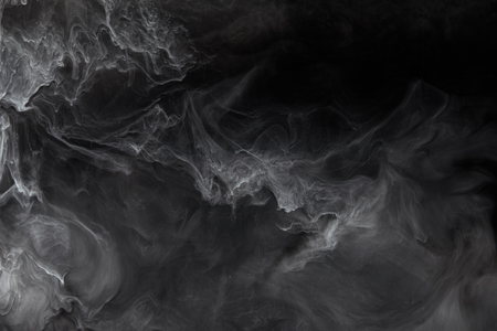 Abstract splash of grey paint on black background