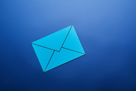 top view of light blue email sign on blue background