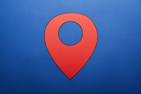 red geolocation drawing on blue background Stock Photo