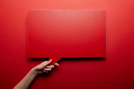 top view of empty speech bubble in red color on red background