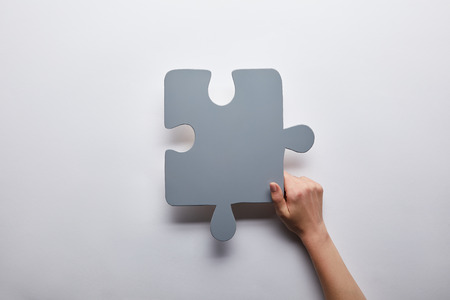 top view of grey puzzle problem solution symbol on grey background Stockfoto