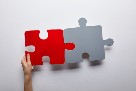 top view of red and grey puzzles problem solution symbol on grey background