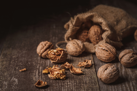 Close up view of walnuts in sack on wooden background Stok Fotoğraf
