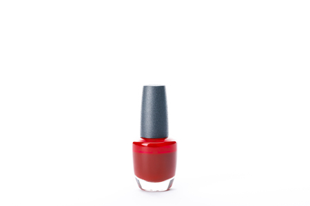 bottle of shiny red nail polish isolated on white