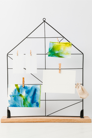 Beautiful abstract paintings and blank cards hanging on clothespins Archivio Fotografico - 116388527
