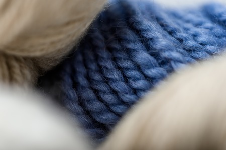 full frame of white and blue knitting clews background