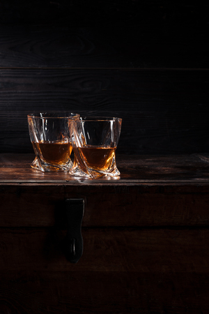 two glasses of whiskey on vintage wooden table 写真素材