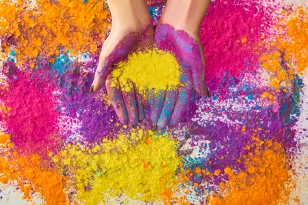 cropped view of woman and multicolored holi powder Stock Photo
