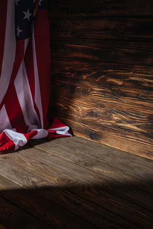close-up view of american flag on wooden background, travel concept