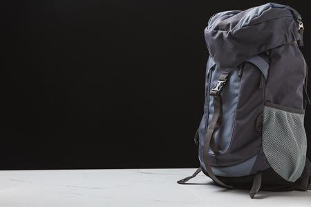 backpack for trekking on black background, travel concept