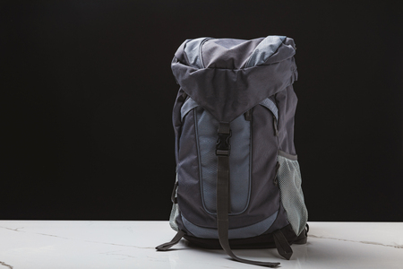 backpack for hiking on black background, travel concept Stock Photo