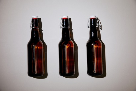 brown bottles with beer on white background Stock Photo