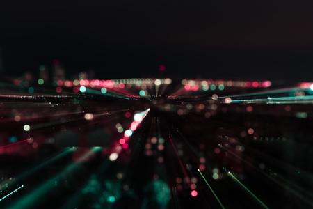 dark cityscape with blurred bright illumination at night