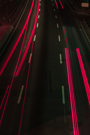 long exposure of road and red lights at night 写真素材