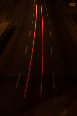 long exposure of road and shiny lights at night 写真素材