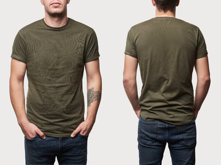 cropped view of tattooed man in basic khaki t-shirt with copy space isolated on white