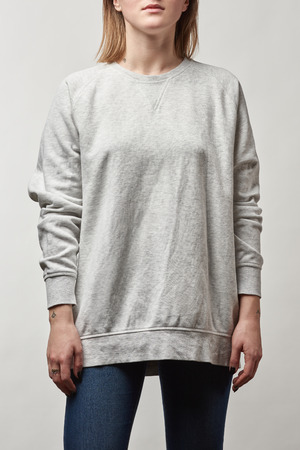 cropped view of young woman in grey hoodie with copy space isolated on white