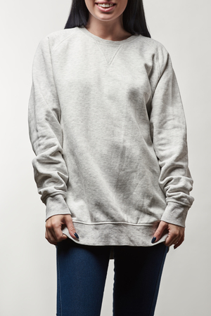 cropped view of smiling young woman in grey hoodie with copy space isolated on white