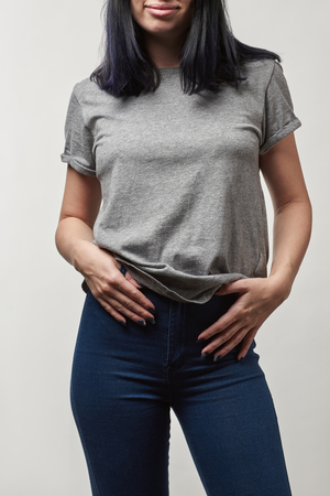 cropped view of young woman in denim and grey t-shirt with copy space isolated on white
