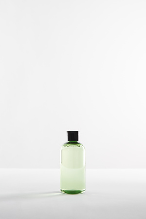 transparent vosmetic bottle with lotion on white background with copy space Reklamní fotografie