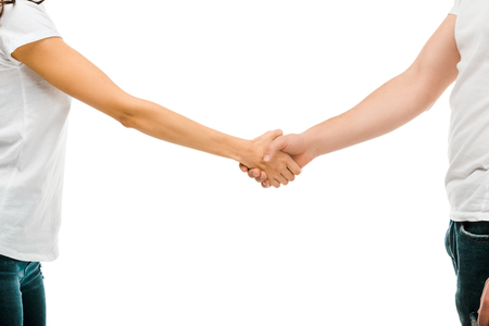 cropped shot of young man and woman shaking hands isolated on white