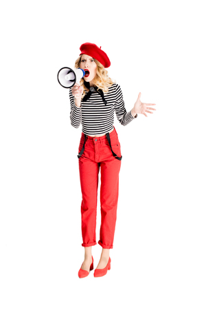 angry woman in red beret screaming in megaphone isolated on white