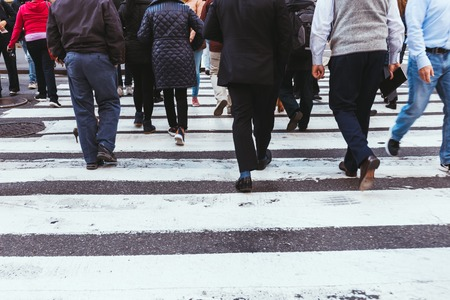 partial view of people crossing road in new york, usa Banco de Imagens