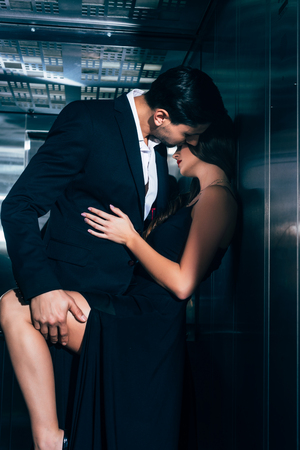 seductive couple kissing and hugging in elevator Stockfoto - 117779232