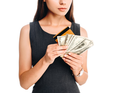 cropped shot of woman in black dress with credit card and cash isolated on white Stock Photo