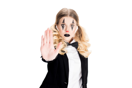 blonde female clown showing stop gesture isolated on white