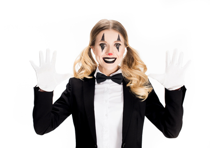 excited female clown smiling while showing white gloves isolated on white Stock Photo